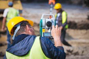 a land surveyor checking his theodolite