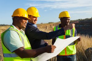 mine manager and workers at quarry discussing future plan