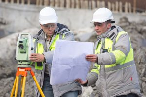 land surveyor examining paperwork for construction project