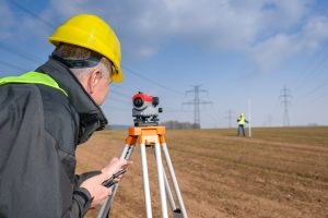 land surveyors preparing for land development