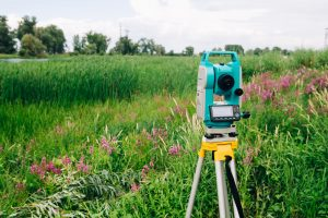 a green field with a theodolite