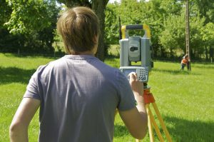 engineer conducting a land survey