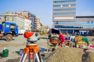 Surveying measuring equipment at construction building site