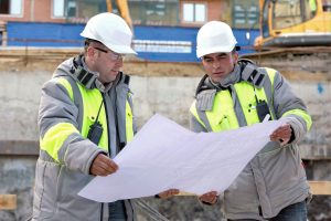 engineers looking over a construction survey
