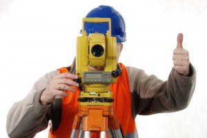 land surveyor behind his equipment