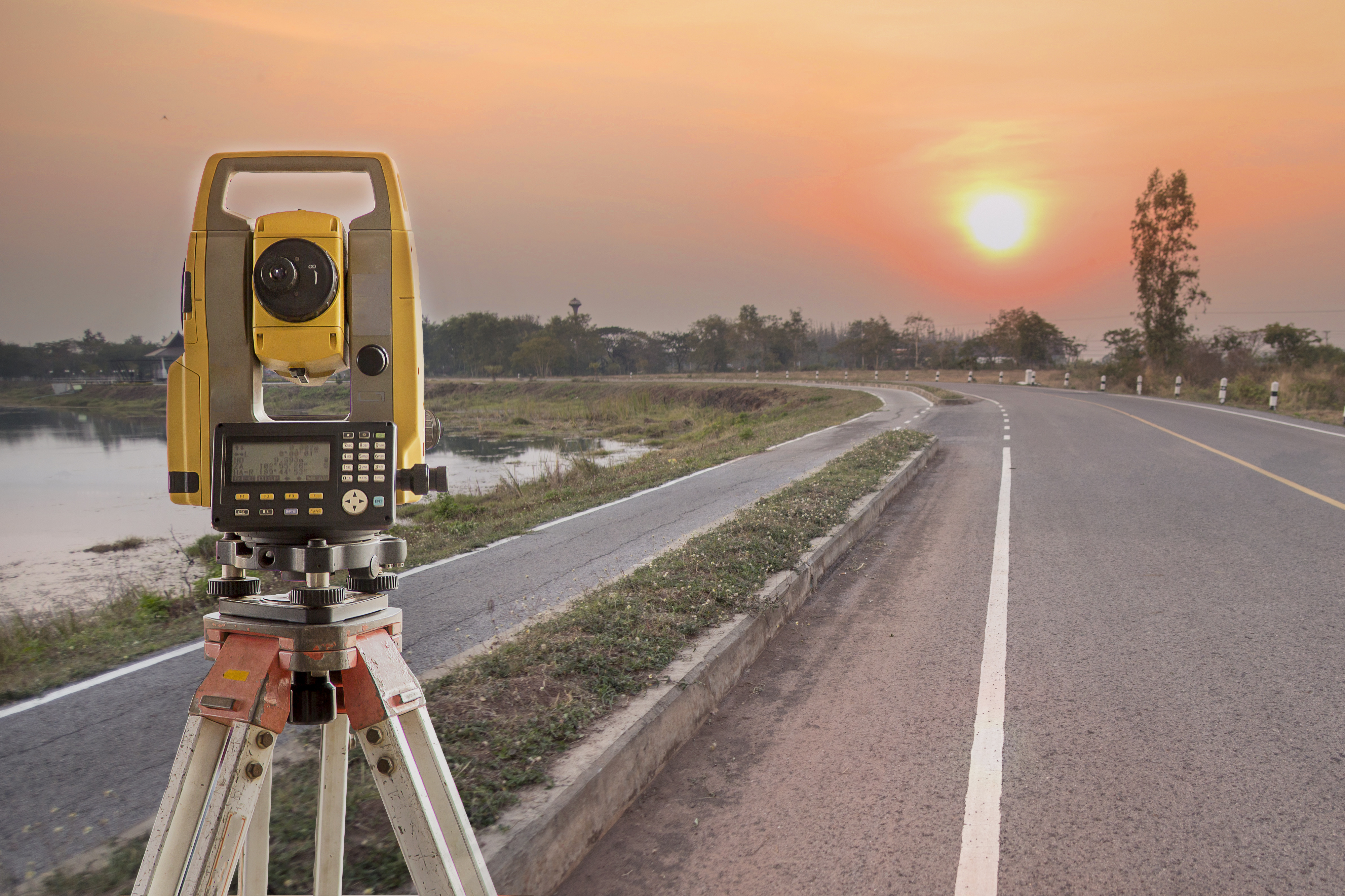 Engineering Survey Equipment By A Road At Sunset