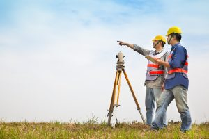 Land surveyor surveying the land