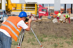 Man performing an ALTA survey