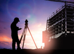 silhouette survey engineer working  in a building site over Blur